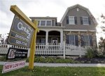 FILE - In this Oct. 20, 2009 file photo, a home with a reduced price for sale in Carmel, Ind. neighborhood is shown. Buying a home is about to get cheaper for a whole new crop of homebuyers � $6,500 cheaper. (AP Photo/Michael Conroy, file)